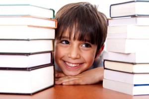 BoyLookingThroughBookscanstockphoto4161502