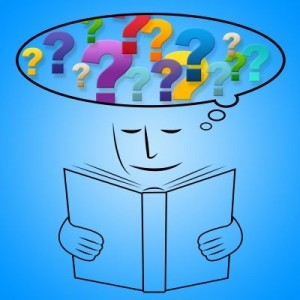 cartoon of child reading book with question marks above - Copy